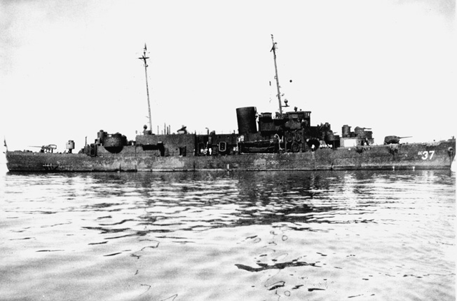 A grime covered Taney as she appeared during the Okinawa campaign. Note the beefed-up superstructure and modified armament configuration necessary to accommodate additional living and working space for the crew.
