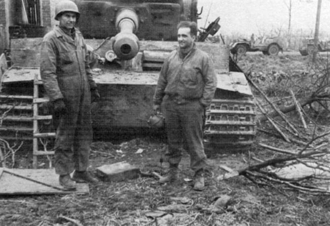 Sergeant Nick Mashlonik, right, poses with an unknown soldier in front of a German Tiger I heavy tank that was destroyed in combat by his M26 Pershing.