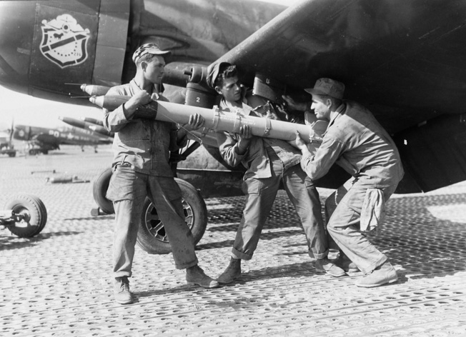 Marines of the Black Sheep Squadron in Pobang, Korea, load a lethal 5-inch rocket on a Corsair fighter- bomber. The Corsair was the only World War II fighter to continue in production after the war.
