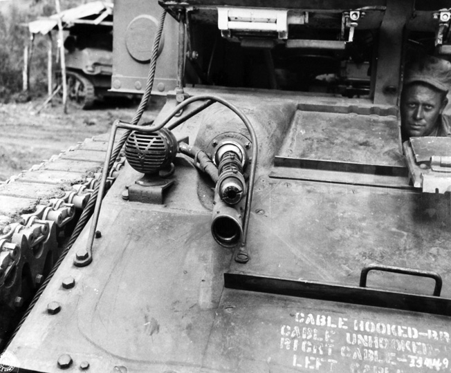This modified M1A1 flame gun was mounted below the Stuart light tank's .30-caliber bow machine gun, providing a more reliable ignition of the flamethrower by tracer bullets fired from the machine gun.