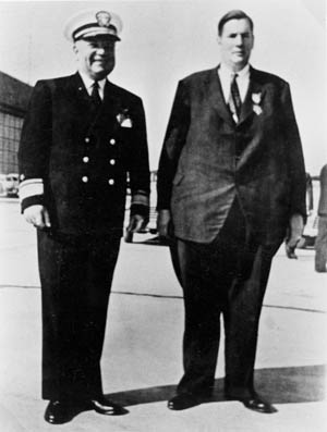 Donald Roebling, the wealthy inventor of the amphibious vehicle that became the primary landing craft of American forces during the war in the Pacific, stands with Admiral Ralph E. Davidson following the ceremony during which Roebling received the Medal of Merit in 1946.