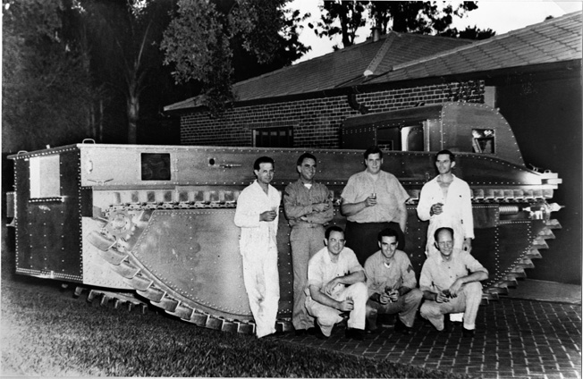 Photographed in the driveway of Donald Roebling's Florida estate, Roebling and his co-workers pose with the fourth generation amphibious vehicle that became the famed Amtrac during World War II.