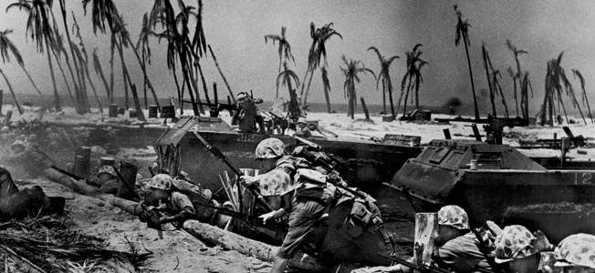 US Marines and their landing craft on the beach during the Battle of Tarawa, a Pacific atoll in the Gilbert Islands (now Kiribati), 20th-23rd November 1943. (Photo by Frederic Lewis/Hulton Archive/Getty Images)