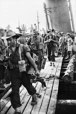 On Mzy 2, 1944, soldiers of the 5th Australian Infantry Division disembark from the destroyer HMAS Vendetta at Madang, New Guinea.