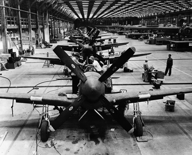 On January 12, 1944, a row of Mustangs fills an assembly line at the Consolidated Vultee aircraft manufacturing plant in Tucson, Arizona. The Mustang served in both the European and Pacific Theaters during World War II.