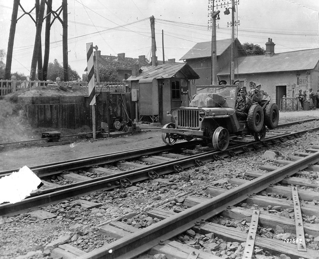 This American Jeep has been fitted with train wheels to match the gauge of the French railway system. This allowed Allied railroad repair personnel to travel up and down the tracks while evaluating the soundness of the lines leading toward supply depots and the front.