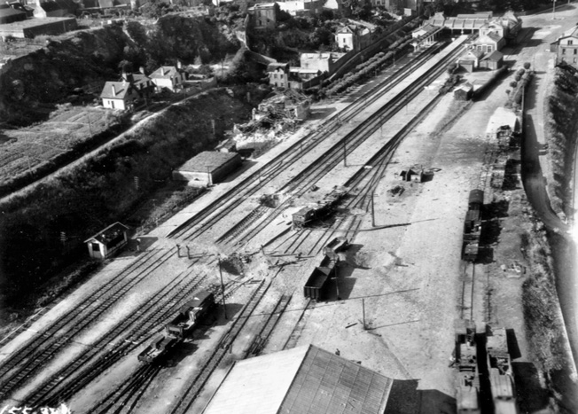 Allied bombers and fighters severely damaged the infrastructure of the French railway system prior to D-Day and during the Normandy campaign. In this August 1, 1944, photo damage to a railyard in the city of Coutances, France, is clearly visible.
