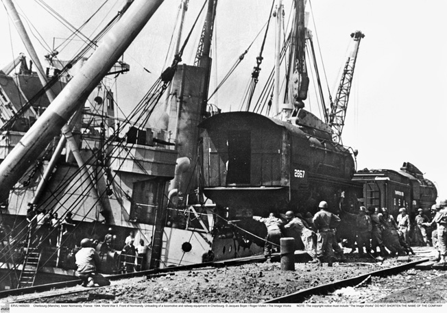 "Cherbourg (Manche), lower Normandy, France: 1944. World War II. Front of Normandy. Unloading of a locomotive and railway equipment in Cherbourg. © Jacques Boyer / Roger-Viollet / The Image Works NOTE: The copyright notice must include ""The Image Works"" DO NOT SHORTEN THE NAME OF THE COMPANY"
