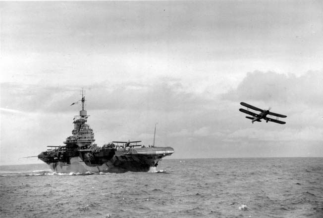 ABOVE: HMS Illustrious launches a Swordfish for a two-hour run to and from Taranto.