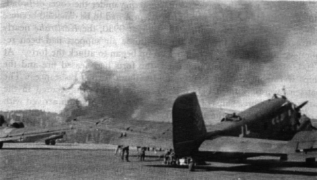 A German Junkers Ju-52 transport aircraft sits at Fornebu airfield in Norway on April 9,1940. The smoke of an ongoing battle between German and Norwegian troops rises in the distance.