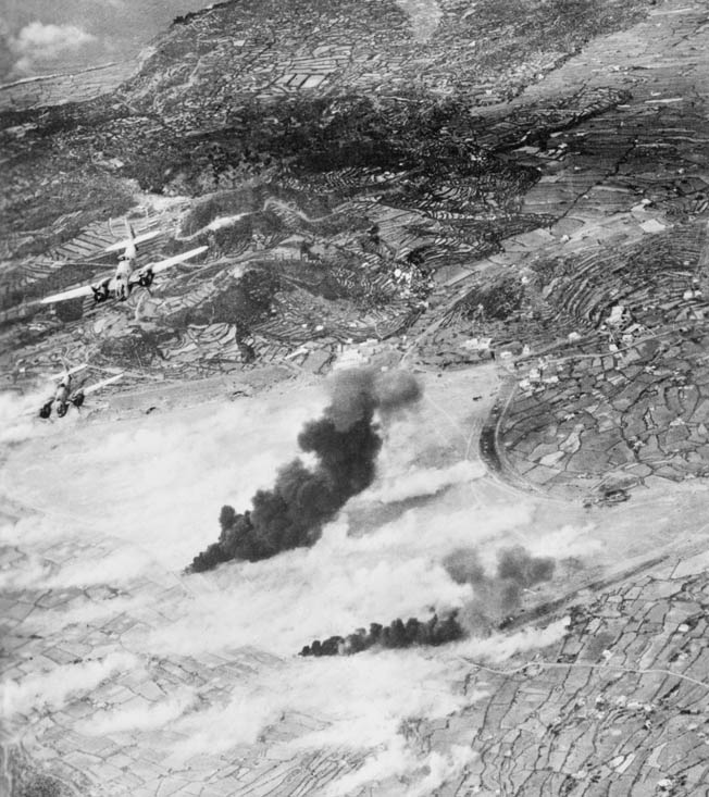 Italian gun emplacements along the coast receive a heavy pounding from Allied bombers during the unceasing attacks. The 10,000-man Italian garrison gave up quickly, supporting the argument that bombardment alone could cause an enemy to surrender.