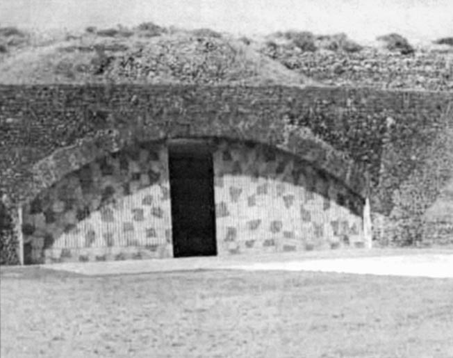 The blastproof, camouflaged doors of an Italian aircraft hangar built into the side of a hill at Pantelleria's Marghana Airdrome.