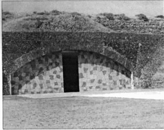 The reinforced main aircraft hangar on Pantelleria is concealed with a mottled camouflage paint scheme.
