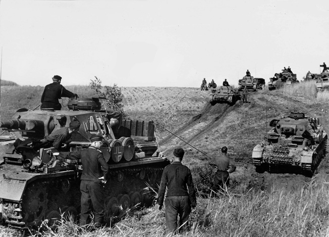 German PzKpfw. IV and PzKpfw. II tanks pause momentarily during their rapid advance into the Soviet Union during the opening days of Operation Barbarossa on June 22, 1941. German pincers encircled hundreds of thousands of Red Army troops, and the initial successes were greater than even the most optimistic war planners had believed possible.