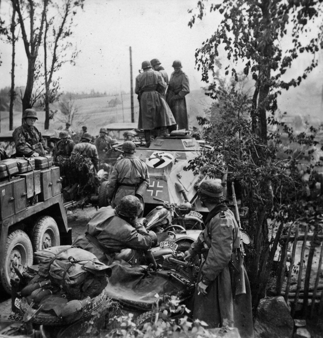 Pausing for a moment during offensive operations on the Eastern Front, battle-hardened panzergrenadiers of the Waffen SS take a moment to rest in July 1941. These troops, belonging to the 3rd SS Panzergrenadier Division Totenkopf, or Death's Head, joined the advance on Linengrad in late June.