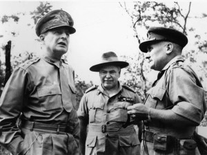 During his first visit to the Kokoda Trail, American General Douglas MacArthur, theater commander, confers with Sir Thomas Blamey, commander of Allied Land Forces in New Guinea, and Maj. Gen. G.S. Allen, who led the Australian Imperial Forces.