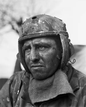 The original photo of John Parks, taken at Mittersheim, France, on December 10, 1944, profoundly reflects the toll the seemingly endless stress of combat takes on a man. Photo by Don Ornitz.