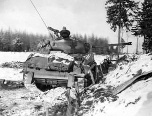 It's star insignia painted dark, an American M4 Sherman tank takes up a position in the snow near the town of Bastogne, Belgium, during the Battle of the Bulge. Note the high-velocity 75mm cannon that replaced the less potent main weapon on the earlier Sherman models.