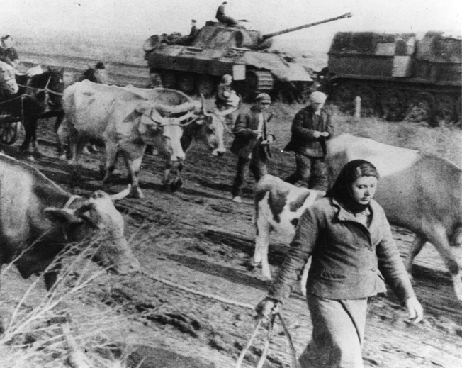Retreating German troops and armored vehicles press Russian civilians and livestock, which were caught up in their path.