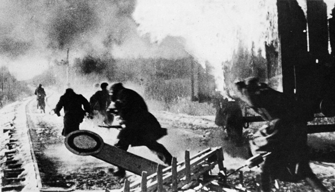 After setting fire to a freight train laden with supplies for the German army, partisans melt away into the neighboring town.
