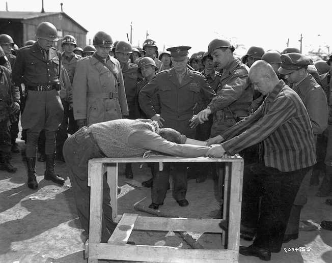 Eisenhower, again with Patton (left) and Bradley, listens as a translator explains some of the torture techniques used at the Ohrdruf concentration camp.