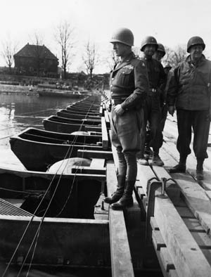 """General Patton celebrates crossing the Rhine River by relieving himself in it. """"The pause that refreshes,"""" he called it."""