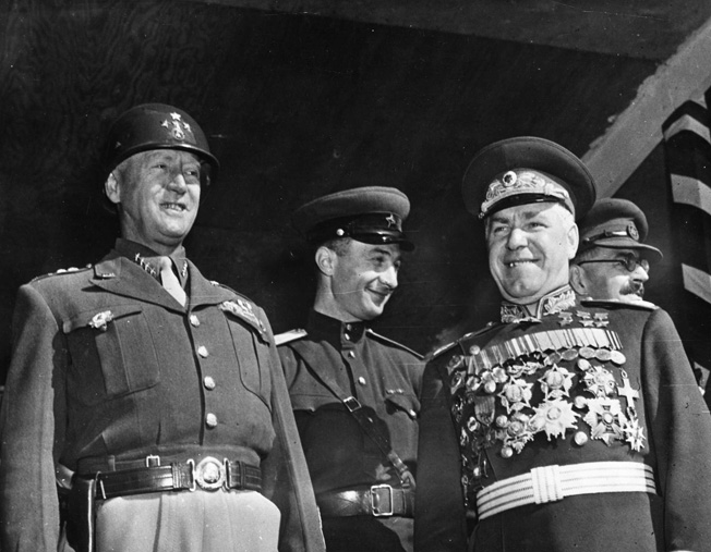 General George S. Patton, Jr. (left) strains to smile in company with Marshal Georgi Zhukov during a September 7, 1945, parade in Berlin. The two were present during activities celebrating the Allied victory over Japan.