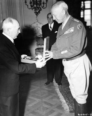 General Patton receives the Order of the White Lion and the Military Cross, first class, from President Eduard Benes of Czechoslovakia, July 27, 1945.