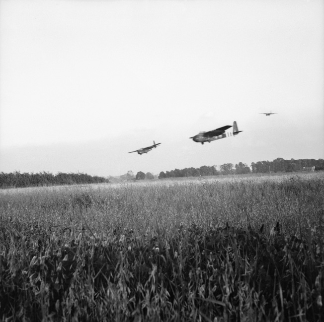 Hamilcar gliders of the British 6th Airborne Division land near the town of Ranville, France, on June 6, 1944. These gliders are carrying Tetrarch light tanks to support the offensive operations of the airborne troops.