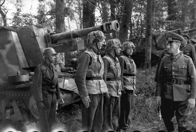 Two weeks prior to D-Day, Field Marshal Erwin Rommel, commander of the German defenses in Normandy, inspects troops of the 21st Panzer Division. This inspection took place in the vicinity of the landing zone of the British 6th Airborne Division.