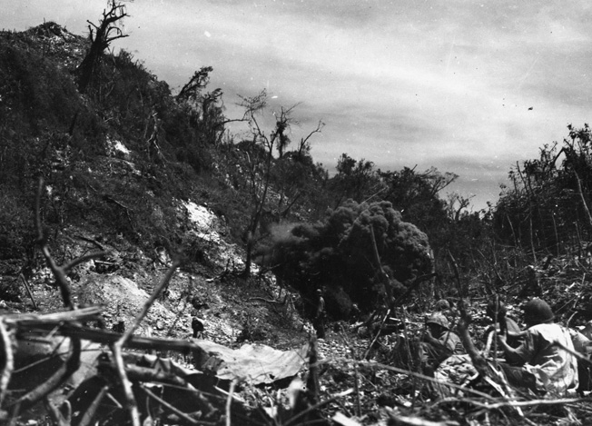 During the slogging advance at the Battle of Peleliu, U.S. Marines blast the Japanese soldiers manning a strongpoint. The island's natural caves were often fortified and reduced the American advance to a crawl.