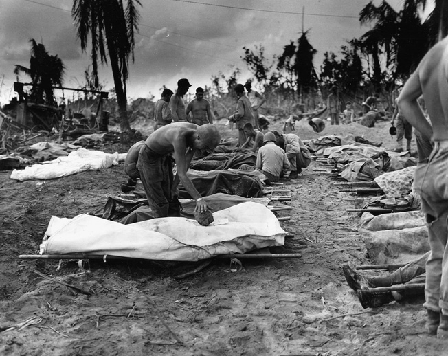 The cost of taking Peleliu to secure the southern flank of General Douglas MacArthur's advance against the Philippines is questioned to this day. Here, the bodies of dead Marines bear mute testimony to the cost and ferocity of the battle.