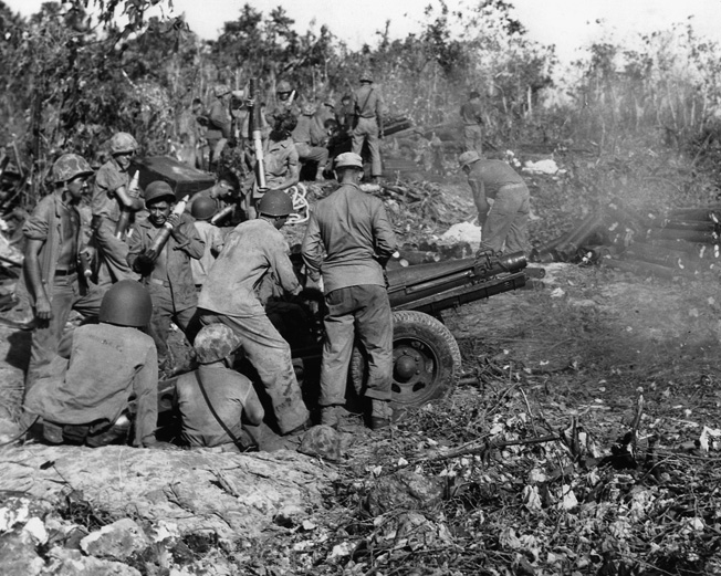 Marine artillery blasts the enemy position just outside Peleliu airfield.