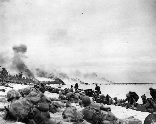 """Marines land on """"Orange One"""" beach at Peleliu. Minutes later, the relative calm would be broken and the Marines would meet fanatical Japanese resistance."""