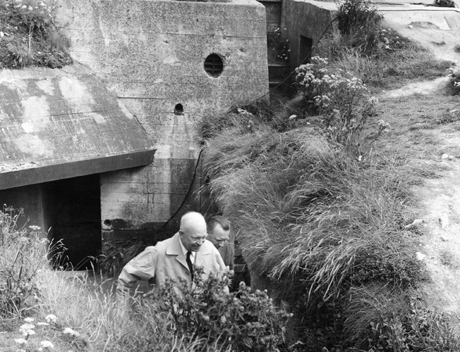 Cronkite and General Eisenhower tour German bunkers in Normandy after the war.