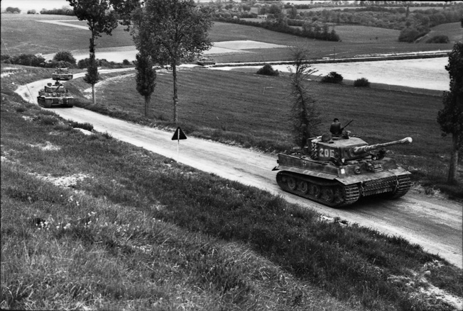 Tiger tank No. 205, belonging to SS Obersturmführer Michael Wittmann, proceeds down a country road in France. Never far from the front, Wittmann became the leading tank ace of the Third Reich and died in his armored vehicle.