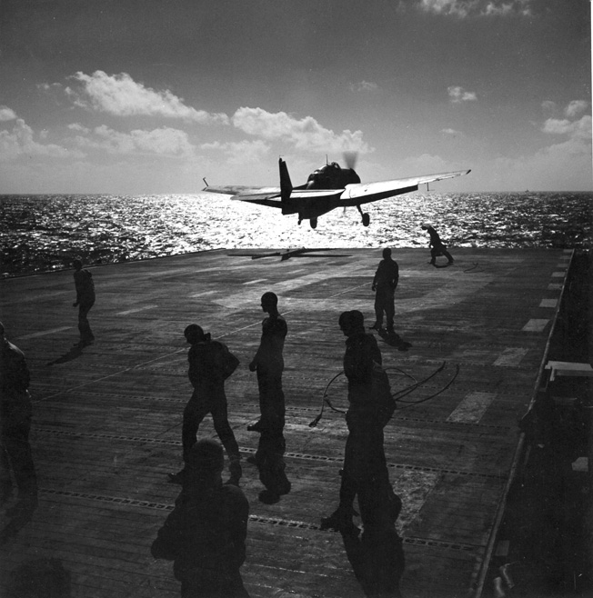 During a strike against Japanese defenses and air installations on Saipan, a Grumman TBF Avenger takes off from the deck of an American aircraft carrier on June 14, 1944. Primarily used as a torpedo bomber, the Avenger was a multipurpose aircraft that could also attack land targets with conventional bombs.