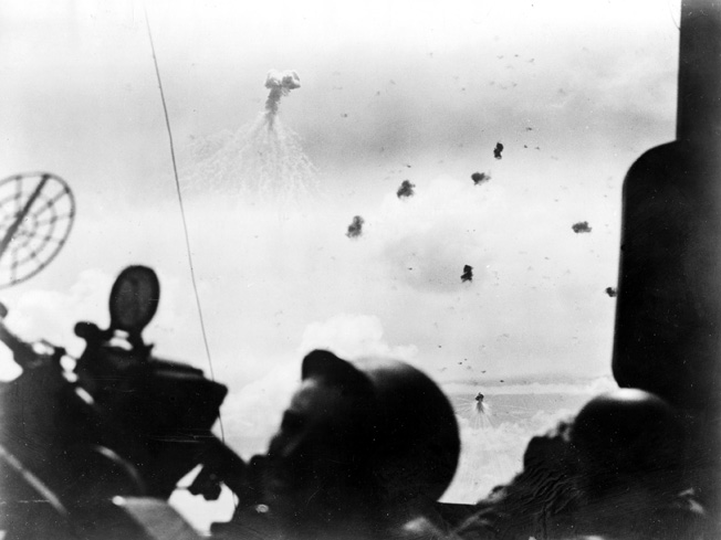 Taken by a U.S. Navy combat photographer aboard the cruiser USS Mobile, this image captures a Japanese dive-bomber attacking the aircraft carrier USS Wasp. Several U.S. carriers, including Wasp, were named for predecessors that had been sunk in action against the Japanese in 1942. Two years later during the Battle of the Philippine Sea, the U.S. Navy was the strongest in the world.