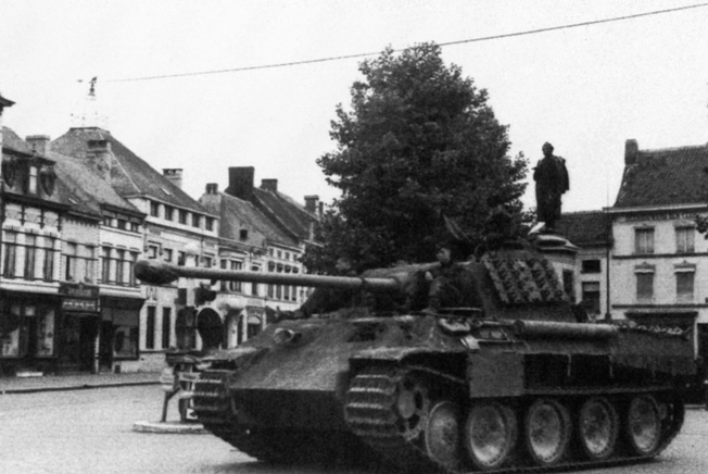 Pausing momentarily in the square of a deserted French town, a Panther medium tank and its 75mm high velocity cannon present a menacing profile. The Panther was designed by German engineers in response to the hugely successful Soviet T-34.