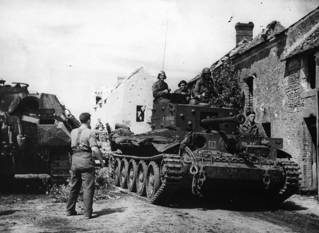Advancing quickly through the shattered town of St. Lambert, France, located on the River Dives between Trun and Chambois, Polish tanks roll toward a junction with other Allied troops to bag 60,000 Germans in the Falaise Pocket.