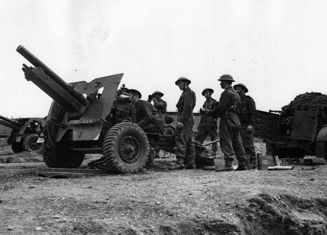 Polish artillerymen prepare to load and fire their 25-pounder field gun during antitank exercises prior to embarkation. for Normandy and their first test in combat.
