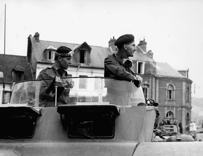 Lieutenant General Guy Simonds watches closely as the first tank of his Canadian II Corps crosses the River Seive in France. The II Corps also included the Polish 1st Armored Division.