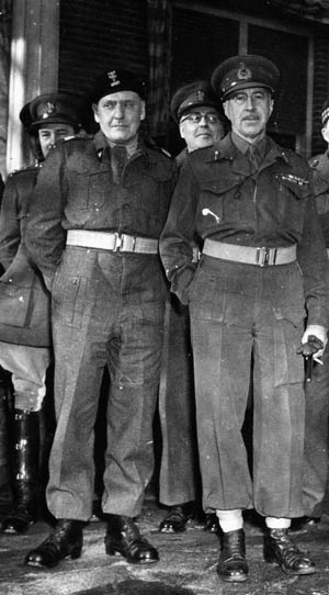 Polish Major General Stanislaw Maczek (left) and British General H.D.G. Crerar pose for photographers during a visit to the headquarters of the First Canadian Army by General Dwight D. Eisenhower on November 29, 1944.