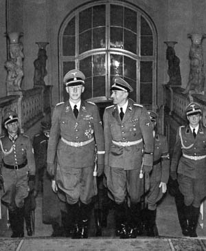 """Reinhard Heydrich (left), a principal participant in the Nazis' Final Solution whose nickname was the """"Butcher of Prague,"""" strides up the stairs of his headquarters in the city. To Heydrich's left is SS Brigadeführer (brigadier general) Carl Hermann Frank, a Sudeten German who enthusiastically sup- ported Heydrich."""