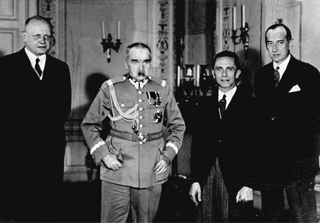 Following a lecture by Nazi Propaganda Minister Josef Goebbels in 1934, Polish Marshal Jozef Pilsudski posed with German dignitaries. Shown left to right are: Hans-Adolf von Moltke, German ambassador to Poland, Pilsudski, Goebbels, and Polish Foreign Minister Jozef Beck.