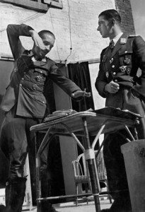 ADOLF GALLAND (1912-1996). German Luftwaffe General and fighter pilot. Photographed with Major Werner Mˆlders. Photograph, 1940.