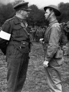 Lt. Col. Charles Vaughn, head of the British Commando training, converses with Maj. William Derby of the US Army Rangers in July 1942.