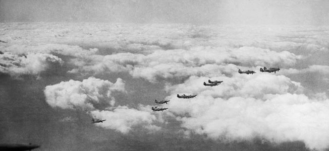 Hawker Hurricane fighters of Bader's 242 Squadron are shown in formation above the coast of England. At the time Bader was shot down in 1941, he was the leading ace of the Royal Air Force in World War II.