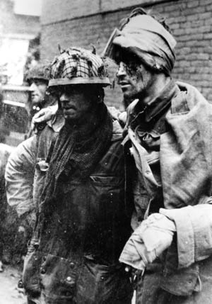Battered survivors of the disaster at Arnhem, these British paratroopers surrendered to the Germans after being cut off and fighting heroically during Operation Market-Garden.