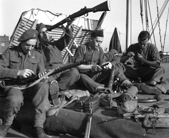 Preparing for their D-Day embarkation, soldiers of the 6th and 7th Battalions, Green Howards, Check their equipment, sort through their kits, and make final preparations to land on Sword Beach.